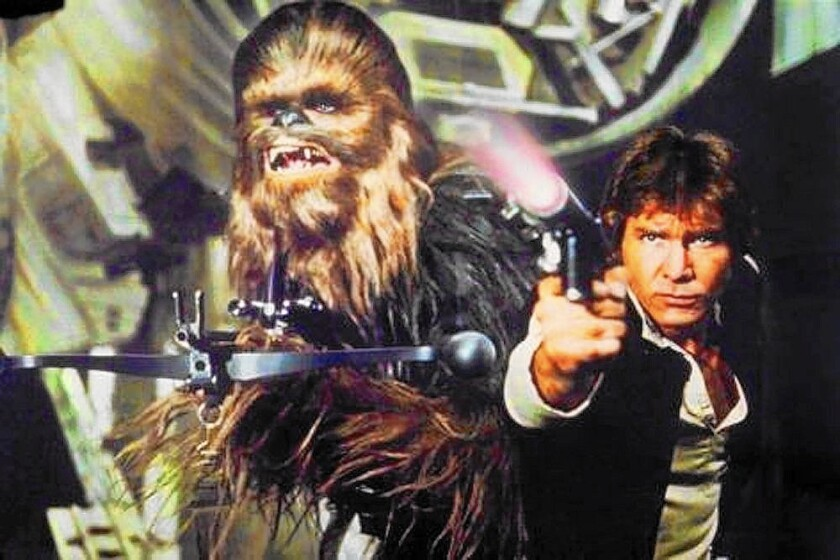"Peter Mayhew as Chewbacca, left, and Harrison Ford as Han Solo in the original 1977 ""Star Wars: Episode IV — A New Hope."""
