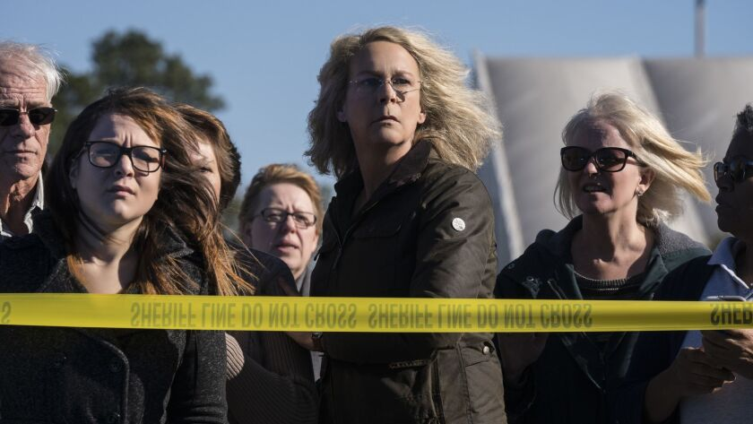 "In ""Halloween,"" Jamie Lee Curtis (center) returns to her iconic role as Laurie Strode, who comes to"