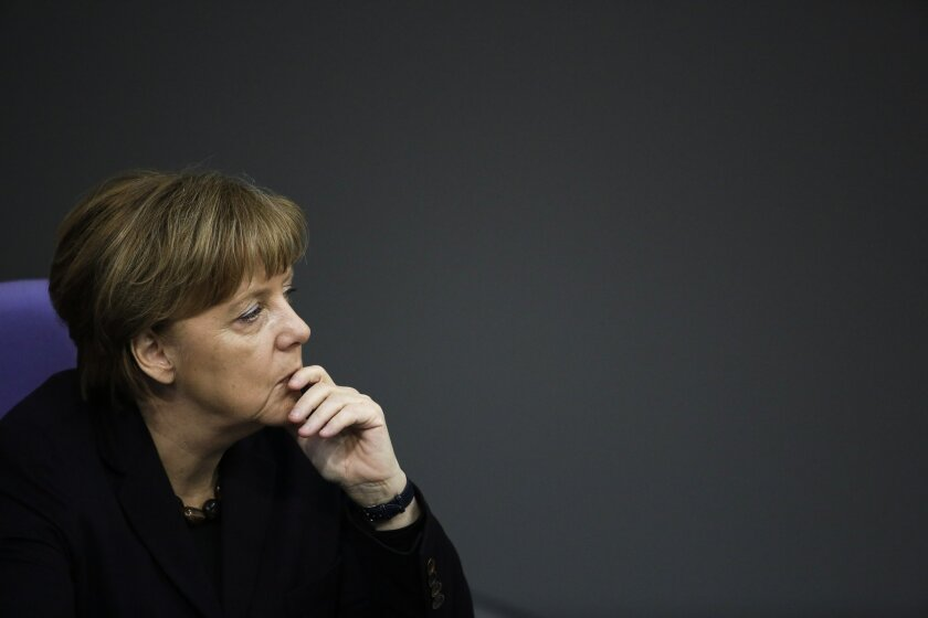 German Chancellor Angela Merkel listens to the debate after her speech a day before an EU council meeting, at the German parliament Bundestag in Berlin, Germany, Wednesday, Feb. 17, 2016. Merkel said that it's in Germany's national interest for Britain to remain in the European Union, and pressed h