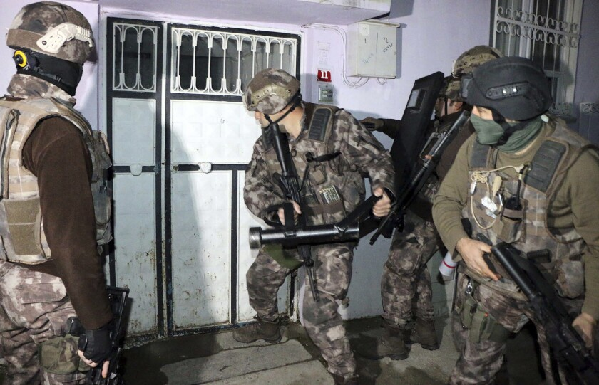Turkish anti-terrorism police break a door during an operation to arrest people over alleged links to Islamic State in Adiyaman, Turkey, on Feb. 5, 2017.
