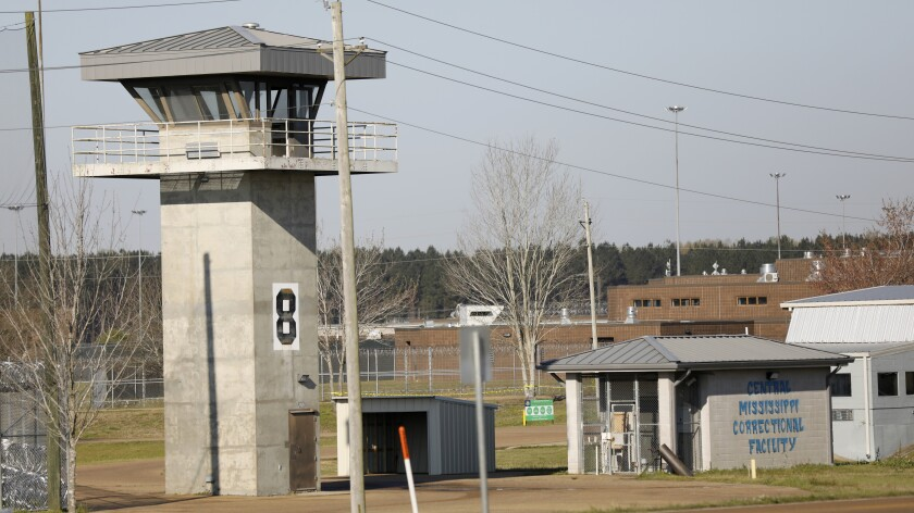 """In this March 20, 2019 photo, a watch tower stands high on the grounds of the Central Mississippi Correctional Facility in Pearl, Miss. Mississippi's habitual offender laws are causing """"extreme"""" prison sentences that are disproportionately affecting African American men and are costing the state millions of dollars for decades of incarceration, according to a new report released Tuesday, Nov. 19, 2019, by a nonprofit advocacy group founded by technology and business executives. Mississippi has the third-highest imprisonment rate among U.S. states, according to the U.S. Justice Department. (AP Photo/Rogelio V. Solis)"""