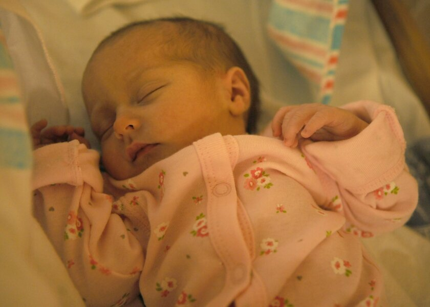Alexa Marie Craig, the first baby born in 2011 at the San Diego Naval Medical Center, sleeps soundly in her newborn crib.