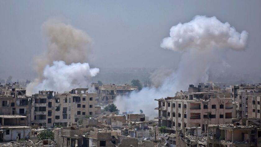 Smoke billows after a reported airstrike by Syrian government forces in the rebel-held parts of the Jobar district on the eastern outskirts of Damascus on Aug. 9.