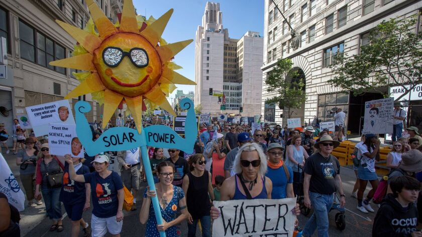 California's large number of environmental advocates, like these participants in the 2017 March for Science in Los Angeles, are one factor that has made recruiting a regional environment chief for the Trump administration a tough sell.