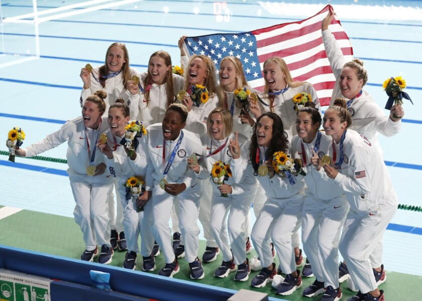 The United States women's water polo team accepts the gold medal for the 2020/2021 Olympic Games in Tokyo.