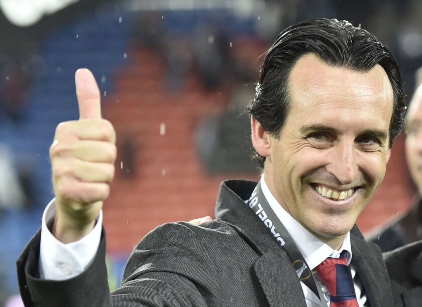 Sevilla head coach Unai Emery celebrates after winning the Europa League final soccer match between Liverpool and Sevilla in Basel, Switzerland, Wednesday, May 18, 2016. Sevilla won the match 3-1. (AP Photo/Martin Meissner)