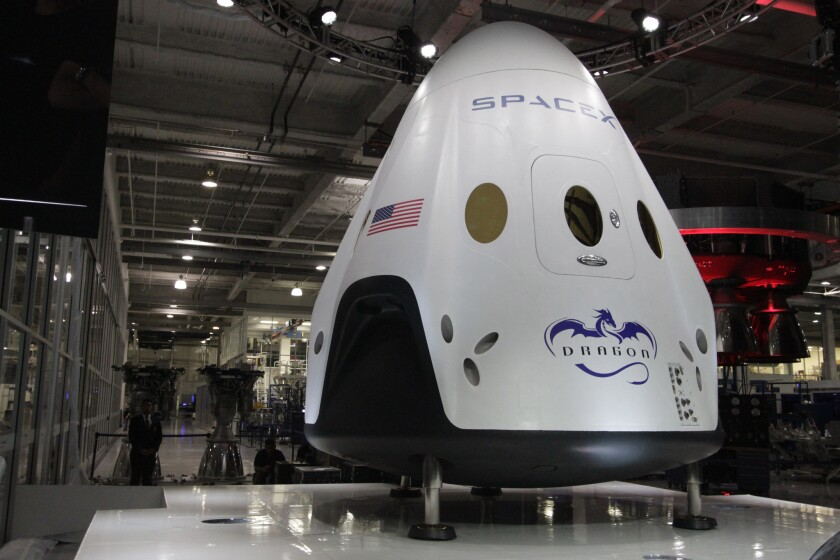 SpaceX's Dragon V2 capsule is designed to carry seven people into space and be reusable.
