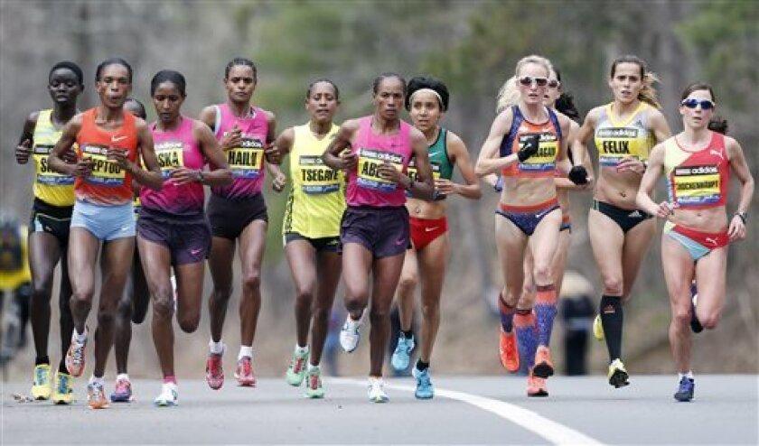 Elite female marathoners, front row from left, Rita Jeptoo, Mamitu Daska, Meserat Debele, Tirifi Beyene, Alemitu Begna, Shalane Flanagan, Ana Felix and Sabrina Mockenhaupt compete on the course in Wellesley, Mass., Monday, April 15, 2013. (AP Photo/Michael Dwyer)