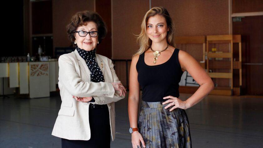 """Director Marta Domingo, left, with soprano Corinne Winters, who plays Violetta, in San Diego Opera's """"La Traviata,"""" which opens April 22 at the San Diego Civic Theatre."""