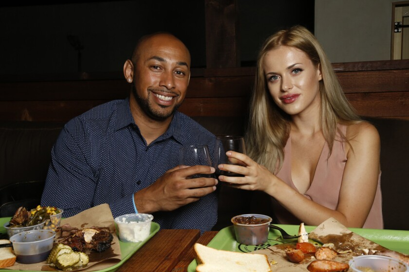Blind daters Jonathan Alvarado and Sarah Sharples enjoying their bbq dinner at Park 101 in Carlsbad.