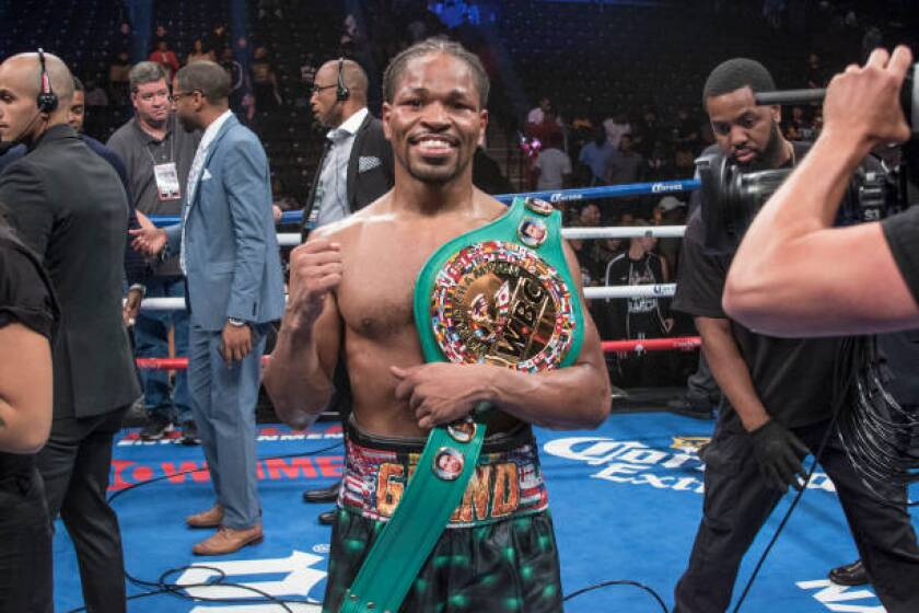 Shawn Porter celebrates after defeating Danny Garcia in a WBC welterweight title bout at the Barclays Center in New York on Sept. 8, 2018.