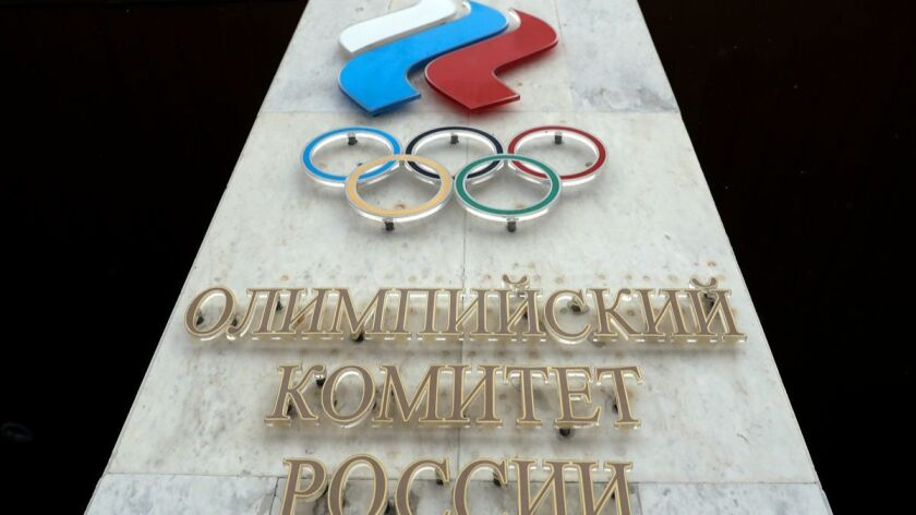 The logo of the Russian Olympic Committee looms over the entrance of the head office in Moscow.