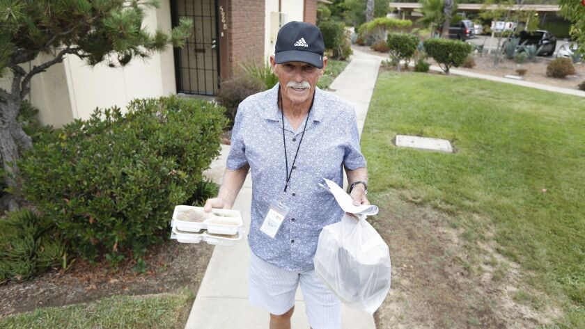 Jewish Family Service volunteer Peter Graham delivers meals to a client in University City. JFS provides 65,000 meals a year in the San Diego area.
