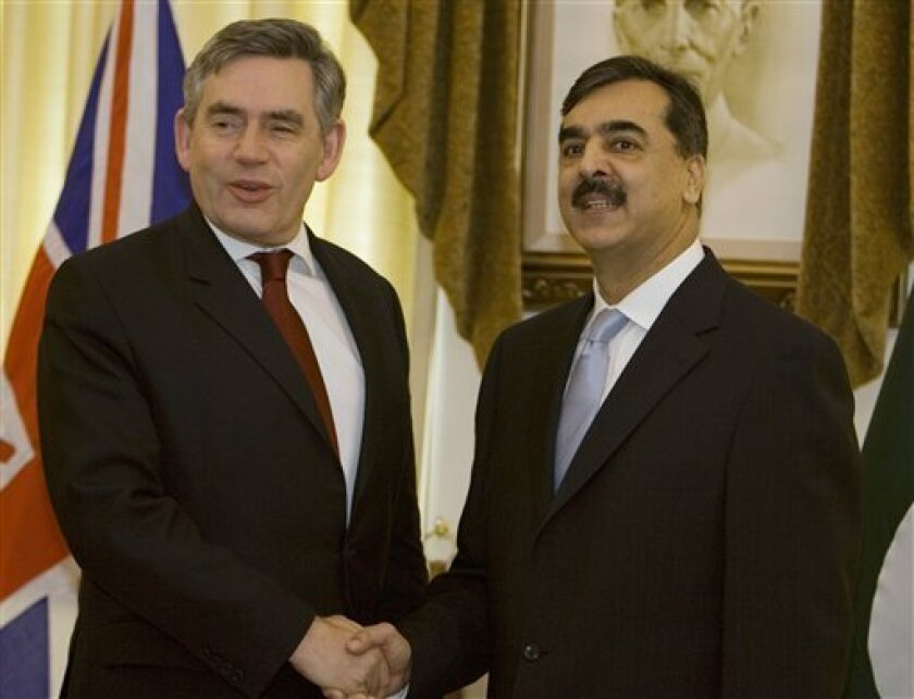 British Prime Minister Gordon Brown, left, shakes hands with his Pakistani counterpart Yousuf Raza Gilani at prime minister's house in Islamabad, Pakistan, on Sunday, Dec. 14, 2008. Brown on Sunday pledged more technical support and funding to help Pakistan and India battle terrorism in the wake of attacks in Mumbai that killed more than 160 people. (AP Photo/B.K.Bangash)