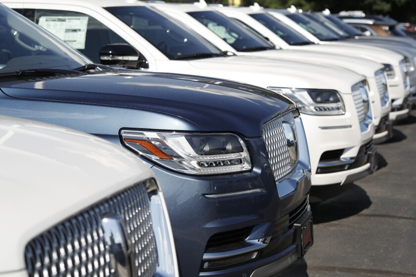 FILE - In this July 28, 2019, file photo unsold 2019 Lincoln Navigators sit at a dealership in Englewood, Colo. On Tuesday, Sept. 24, the Conference Board releases its September index on U.S. consumer confidence. (AP Photo/David Zalubowski, File)