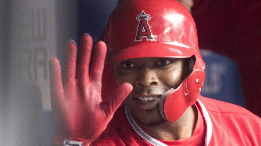 Los Angeles Angels' Justin Upton celebrates in the dugout after hitting a home run against the Toron