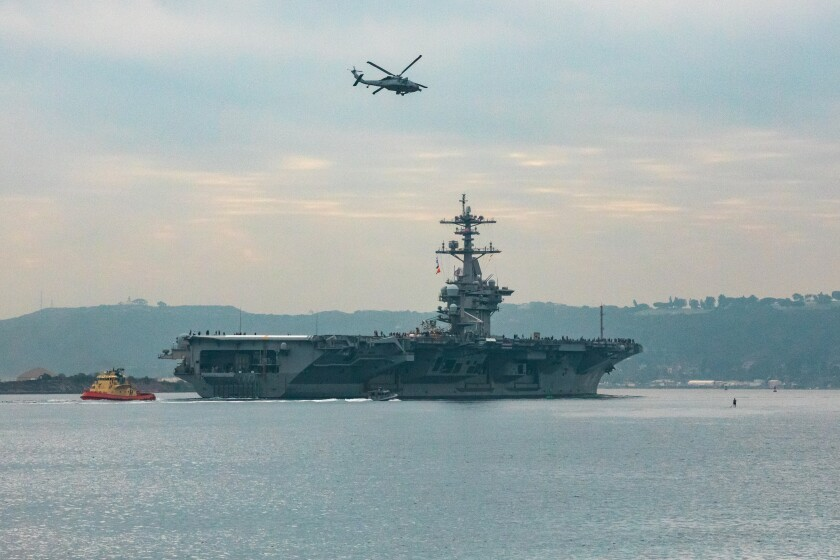 The USS Theodore Roosevelt leaves San Diego Harbor for deployment on Monday.