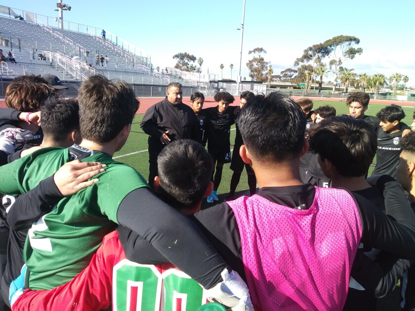 Oceanside boys soccer coach Frank Zimmerman his team prior to a 3-2 comeback victory over Eastlake.