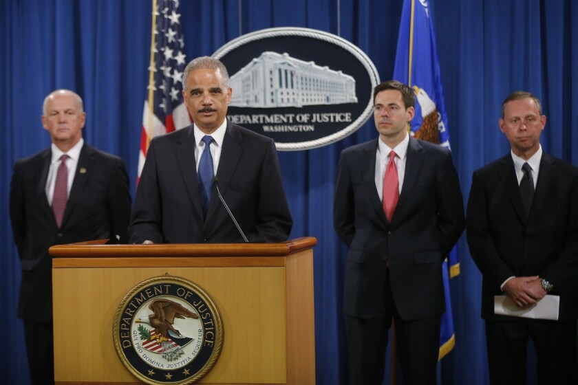 Attorney General Eric Holder announces that a U.S. grand jury has charged five Chinese hackers with economic espionage and trade secret theft.