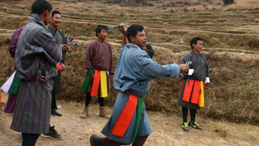 Bhutanese villagers throw darts in a game during the celebration of Bhutanese New Year at Paro on Feb. 27.