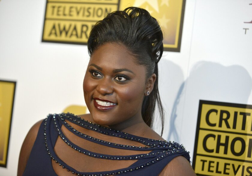 """FILE - In a Thursday, June 19, 2014 file photo, actress Danielle Brooks arrives at the Critics' Choice Television Awards at the Beverly Hilton Hotel, in Beverly Hills, Calif. Brooks is going from orange to purple _ jumping from """"Orange Is the New Black"""" on TV to a Broadway stage in the upcoming """"The Color Purple"""" revival. Performances start Nov. 9, 2015, at the Bernard B. Jacobs Theatre. The musical is a stage version of Alice Walker's Pulitzer Prize-winning novel. (Photo by Richard Shotwell/Invision/AP)"""
