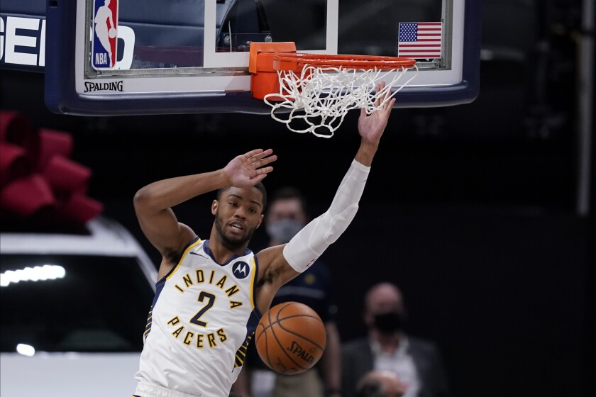 Pacers guard Cassius Stanley dunks against the 76ers.
