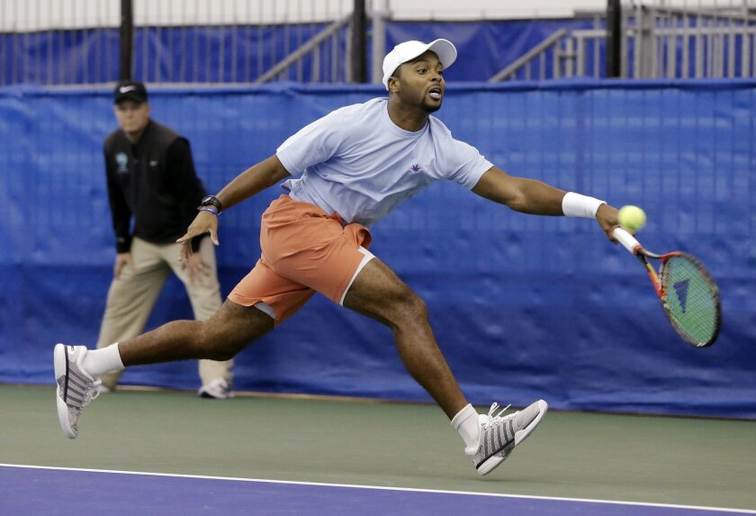 Donald Young returns a shot to Ricardas Berankis, of Lithuania, in a quarterfinal at the Memphis Open tennis tournament Friday, Feb. 12, 2016, in Memphis, Tenn. (AP Photo/Mark Humphrey)