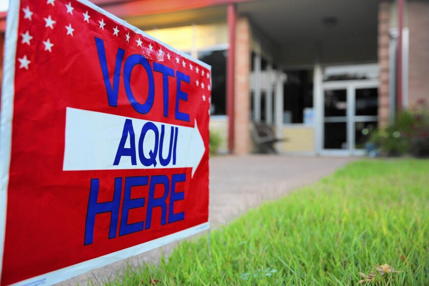 A bilingual sign points to a polling station in Austin, Texas.