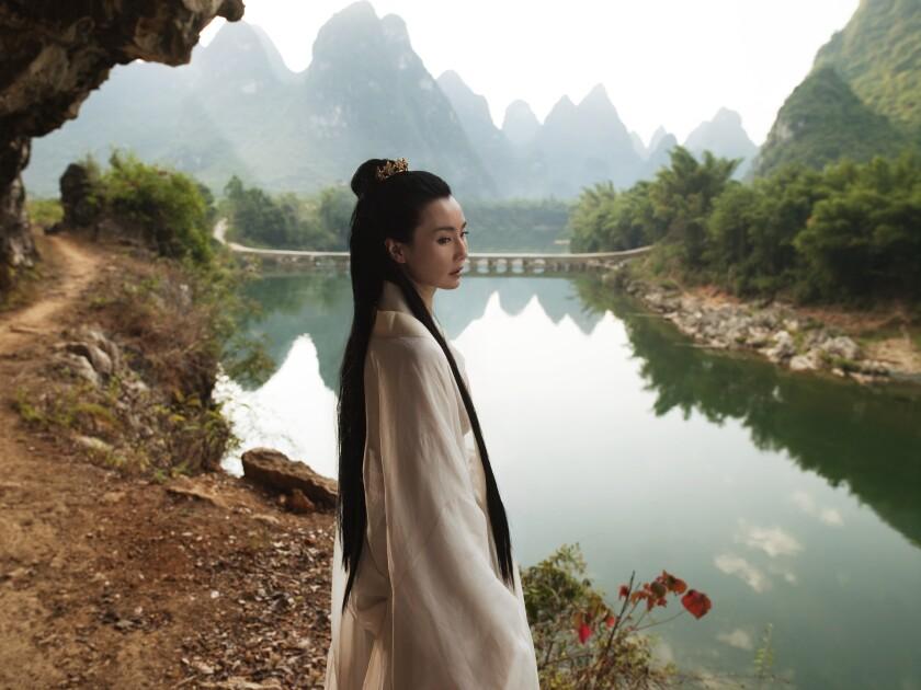 """A still from Isaac Julien's film """"Better Life (Ten Thousand Waves)"""" featuring Maggie Cheung"""