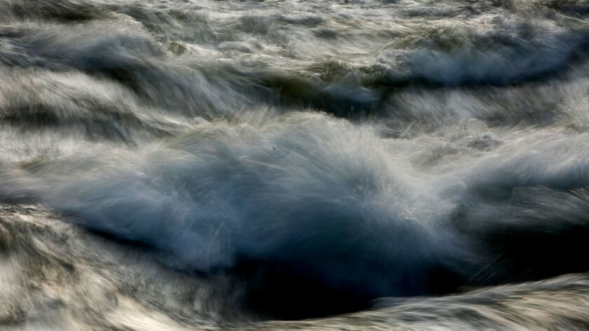 YOSEMITE VALLEY, CALIFORNIA, MAY 4, 2017: The water in the Merced River churns and roars near the Po