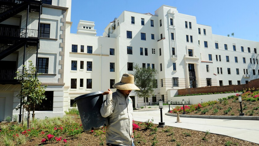 A gardener works in the yard at the former Linda Vista Hospital, which now provides affordable housing.