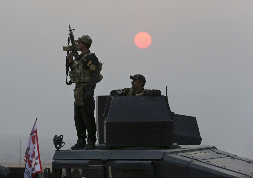 Iraq's elite counterterrorism forces advance toward Islamic State positions as fighting to retake the extremist-held city of Mosul enters its second week in the village of Tob Zawa on Oct. 24, 2016.
