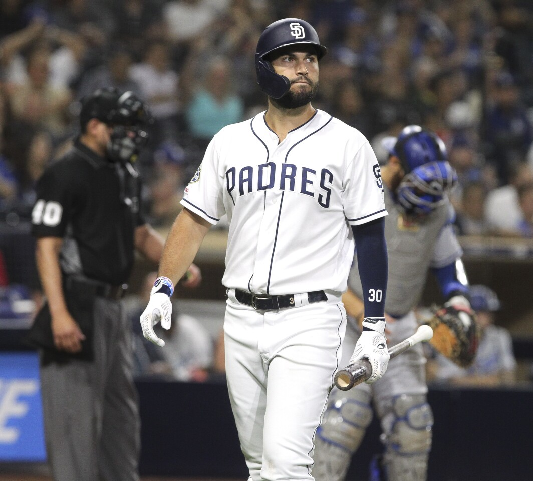 The Padres' Eric Hosmer walks back to the dugout after striking out in the tenth inning against the Dodgers at Petco Park on Wednesday, August 28, 2019 in San Diego, .