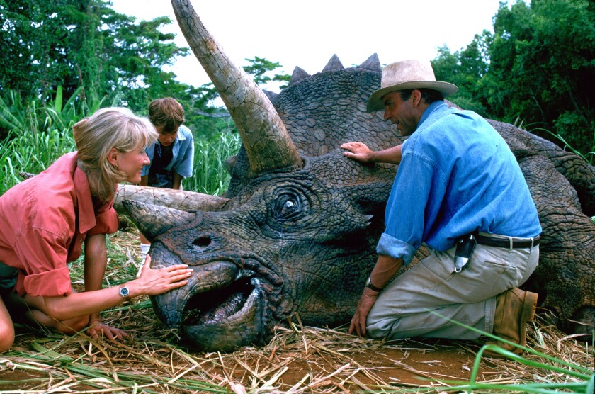 """This image released by Universal Pictures shows, from left, Laura Dern, Joseph Mazzello and Sam Neill in a scene from the 1993 film """"Jurassic Park."""" With all major new releases postponed until at least Labor Day weekend due to the pandemic, summer moviegoing has belonged to the classics. """"Jurassic Park"""" has led them all with a bit more than $3 million in ticket sales this summer, according to several people who have seen box-office grosses. (Universal Pictures via AP)"""