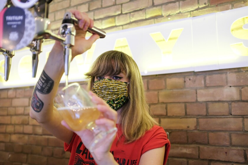 A staff member at Solvay Society brewery in Leytonstone in East London pours a beer on Saturday.