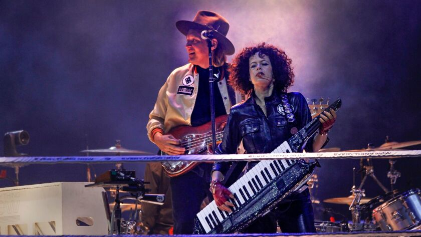 Win Butler and Régine Chassagne of Arcade Fire perform Wednesday at Viejas Arena in San Diego.