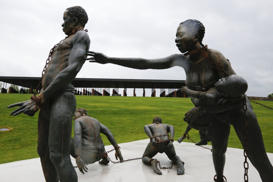 Statues of slaves chained together at the National Memorial for Peace and Justice in Montgomery, Ala.