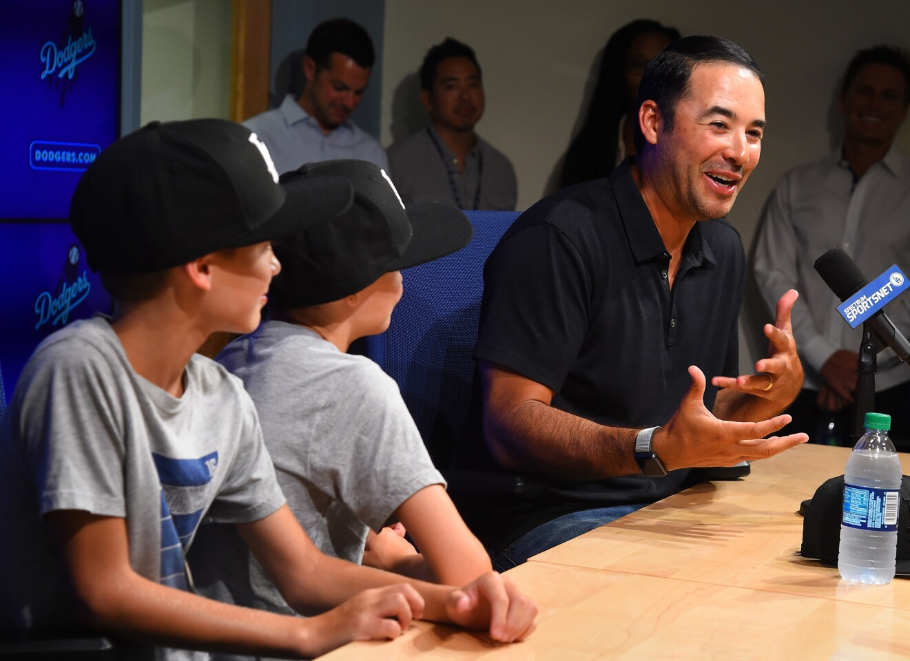 LOS ANGELES, CA - AUGUST 03: Former MLB player Andre Either answers questions from the media about his retirement as his sons Retton, 8 and Dreson, 10 look on before the game between the Los Angeles Dodgers and the Houston Astros at Dodger Stadium on August 3, 2018 in Los Angeles, California. (Photo by Jayne Kamin-Oncea/Getty Images) ** OUTS - ELSENT, FPG, CM - OUTS * NM, PH, VA if sourced by CT, LA or MoD **