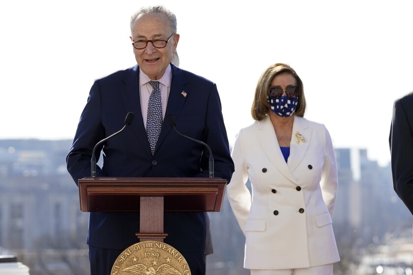 Senate Majority Leader Chuck Schumer of N.Y., speaks as House Speaker Nancy Pelosi of Calif., holds an enrollment ceremony for the $1.9 trillion COVID-19 relief bill, on Capitol Hill, Wednesday, March 10, 2021, in Washington. (AP Photo/Alex Brandon)