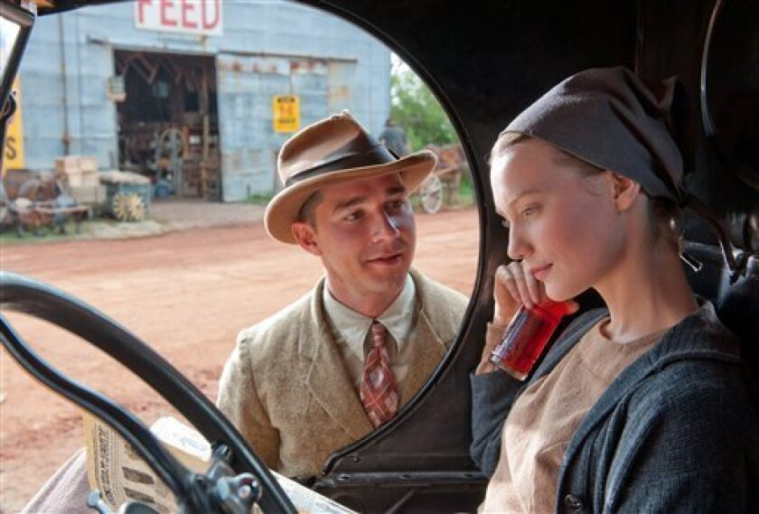 """This film image released by The Weinstein Company shows Shia LaBeouf, left, and Mia Wasikowska in a scene from """"Lawless."""" (AP Photo/The Weinstein Company, Richard Foreman, Jr.)"""