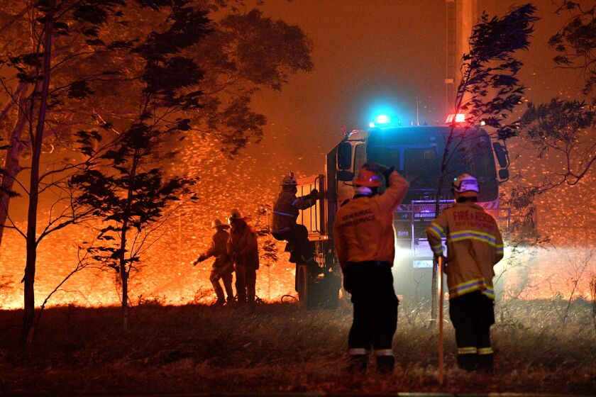 Australian firefighters battle a wildfire near the New South Wales town of Nowra.