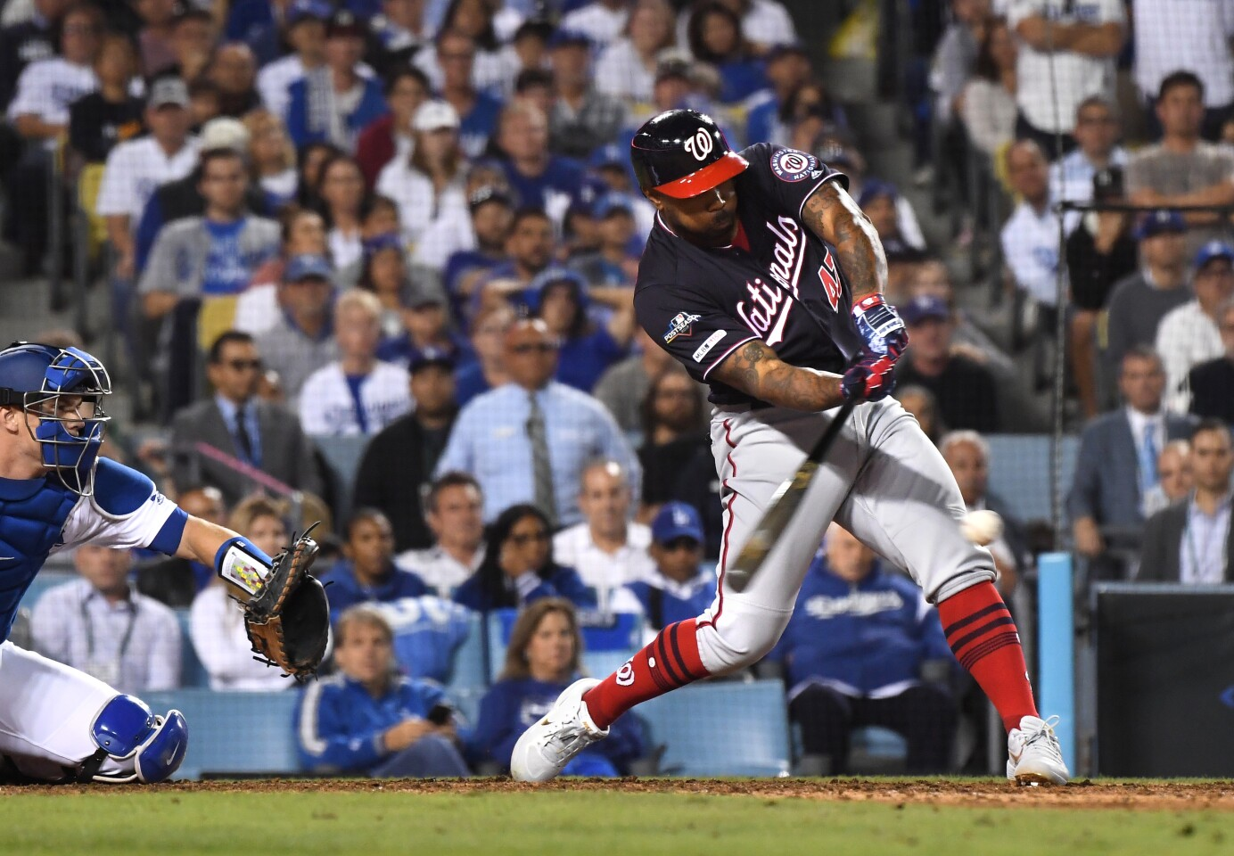 LOS ANGELES, CALIFORNIA OCTOBER 9, 2019-Nationals Howie Kendrick hits a grand slam agaisnt the Dodgers in the 10th inning in Game 5 of the NLDS at Dodger Stadium Wednesday. (Wally Skalij/Los Angeles Times)