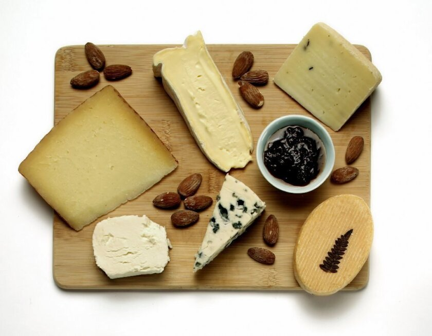 Clockwise from top left: Manchego, fromager d'affinois, sheep's milk cheese with truffles, grès d'Alsace, Roquefort and chevre.