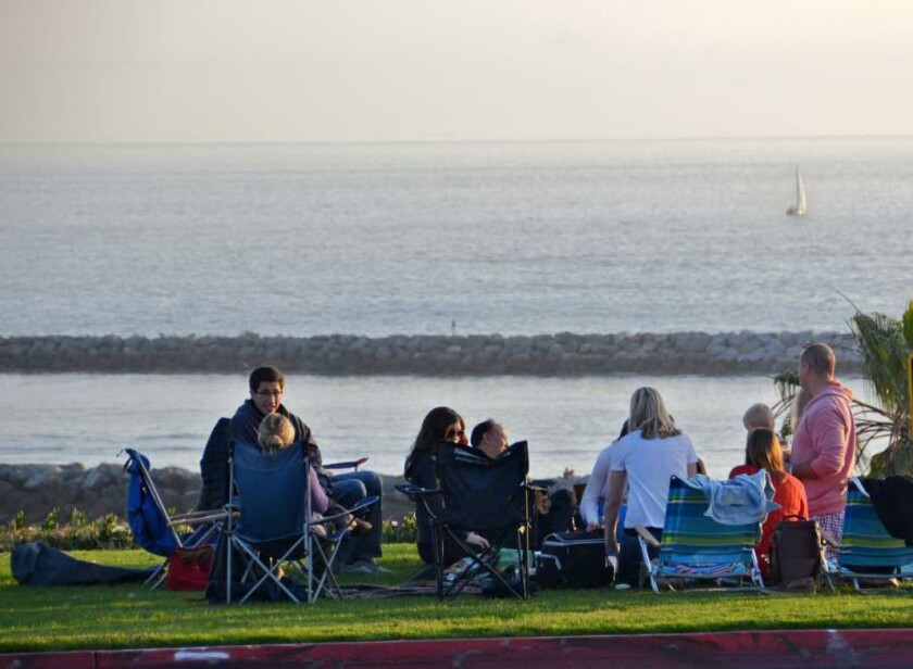 The group of friends and neighbors known as Larkspuria meet up on Friday nights on the bluff above Big Corona to enjoy the sunset.