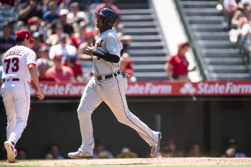 Detroit Tigers' Jonathan Schoop scores on a two-run single by Miguel Cabrera during the fifth inning of a baseball game against the Los Angeles Angels in Anaheim, Calif., Sunday, June 20, 2021. (AP Photo/Kyusung Gong)