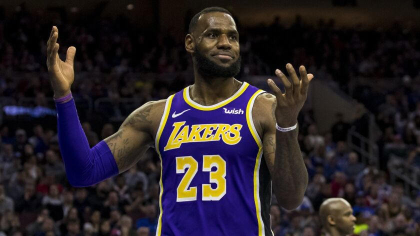 Los Angeles Lakers' LeBron James reacts during the second half of an NBA basketball game against the