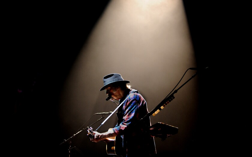 Rock and Roll Hall of Fame member Neil Young performs at the Forum duing his Rebel Content tour in Inglewood Wednesday.