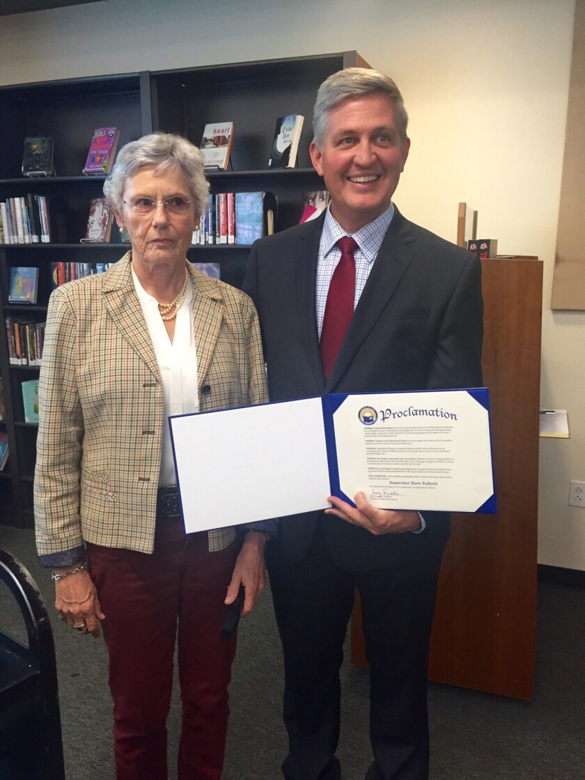 Mary Frumkin, president of Friends of the Solana Beach Library, and San Diego County Supervisor Dave Roberts.