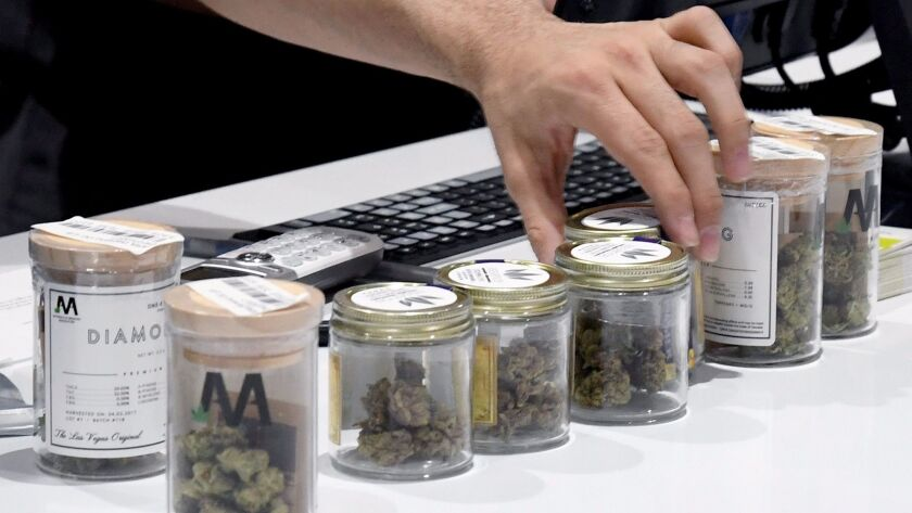 An employee lines up cannabis products at Essence Vegas Cannabis Dispensary after recreational marij