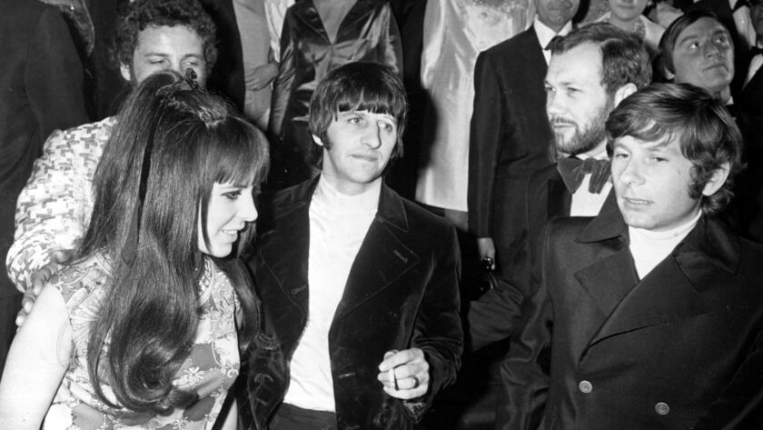 Director Roman Polanski, far right, with Beatles drummer Ringo Starr, center, and his wife, Maureen, right, at Cannes on May 15, 1968.